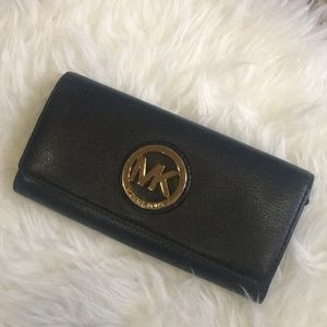 • Michael Kors black leather wallet •